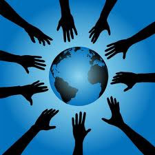 Hands reaching to globe of the world